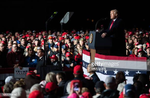 US President Donald Trump speaks during a campaign rally at Central Wisconsin Airport in Mosinee Wisconsin on October 24 2018