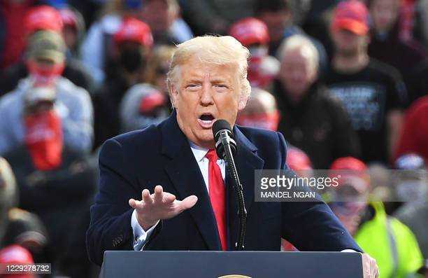 President Donald Trump speaks during a campaign rally at Manchester-Boston Regional Airport in Londonderry, New Hampshire on October 25, 2020. -...