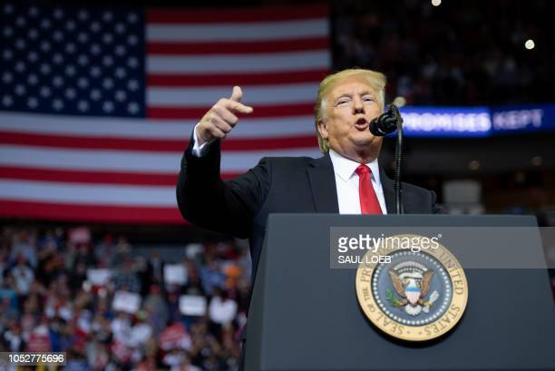 US President Donald Trump speaks during a campaign rally at the Toyota Center in Houston Texas on October 22 2018