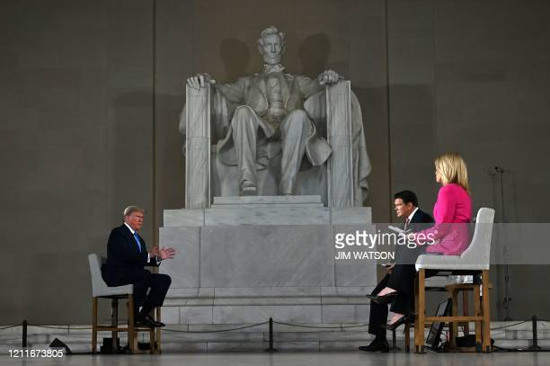 """President Donald Trump speaks during a Fox News virtual town hall """"America Together: Returning to Work,"""" event, with anchors Bret Baier and Martha..."""