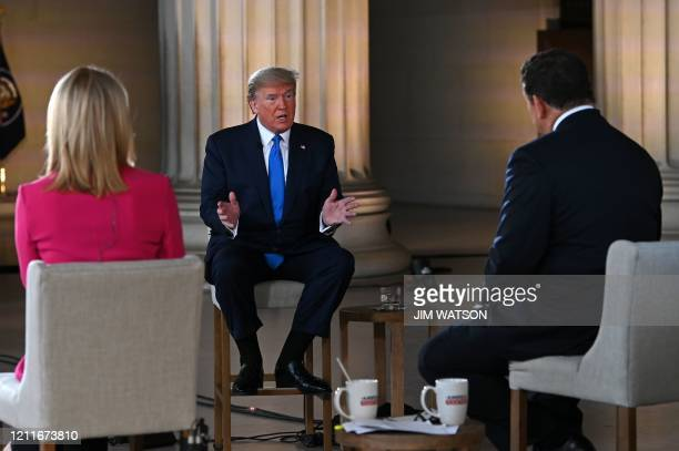 US President Donald Trump speaks during a Fox News virtual town hall America Together Returning to Work event with anchors Bret Baier and Martha...