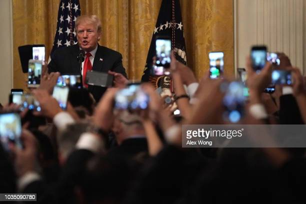 S President Donald Trump speaks during a Hispanic Heritage Month celebration at the East Room of the White House September 17 2018 in Washington DC...