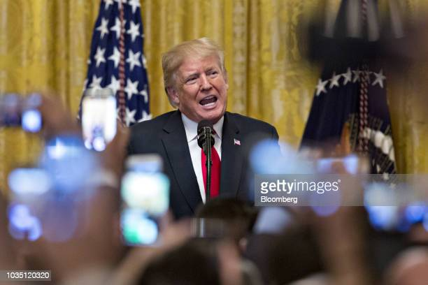 US President Donald Trump waves after speaking during a Hispanic Heritage Month celebration in the East Room of the White House in Washington DC US...
