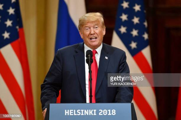 US President Donald Trump speaks during a joint press conference with Russia's President after a meeting at the Presidential Palace in Helsinki on...