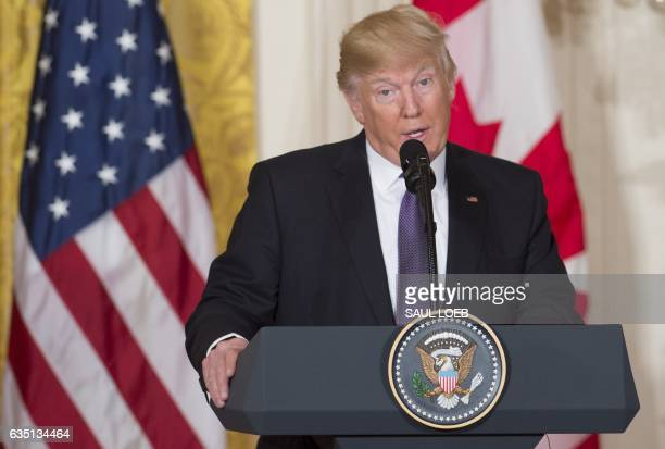 US President Donald Trump speaks during a joint press conference with Canadian Prime Minister Justin Trudeau in the East Room of the White House in...