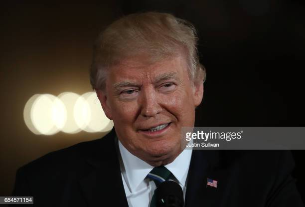 S President Donald Trump speaks during a joint press conference with German Chancellor Angela Merkel in the East Room of the White House on March 17...