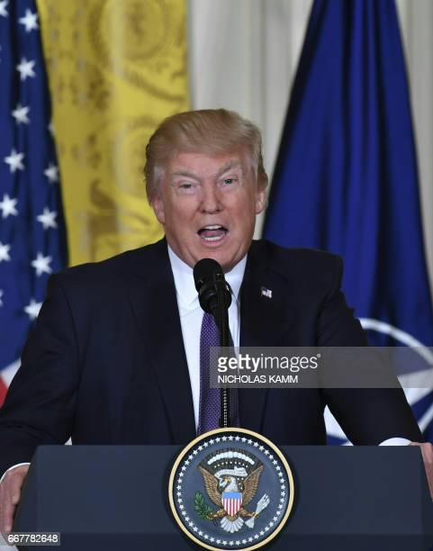 US President Donald Trump speaks during a joint press conference with NATO Secretary General Jens Stoltenberg in the East Room at the White House in...