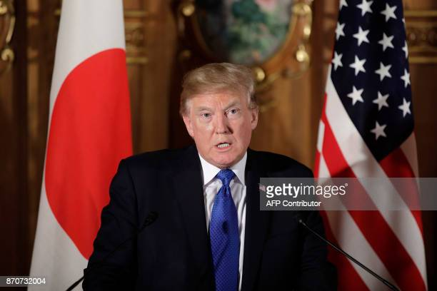 US President Donald Trump speaks during a joint press conference with Japanese Prime Minister Shinzo Abe at Akasaka Palace in Tokyo on November 6...