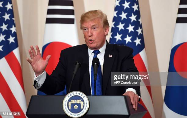 US President Donald Trump speaks during a joint press conference with South Korean President Moon JaeIn at the presidential Blue House in Seoul on...