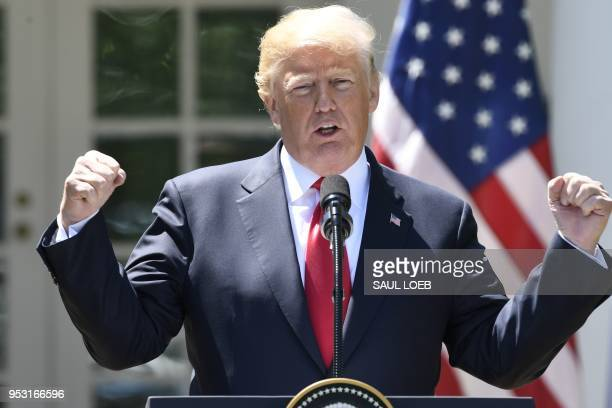 US President Donald Trump speaks during a joint press conference with Nigerian President Muhammadu Buhari in the Rose Garden of the White House on...