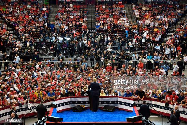 """President Donald Trump speaks during a """"Keep America Great"""" campaign rally at the BB&T Center in Sunrise, Florida on November 26, 2019."""