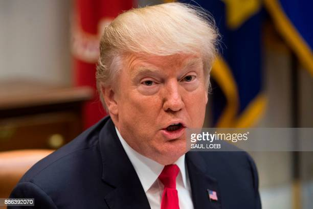 US President Donald Trump speaks during a lunch meeting with Republican members of the Senate in the Roosevelt Room of the White House in Washington...