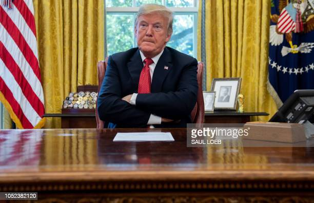 US President Donald Trump speaks during a meeting about cutting business regulations in the Oval Office of the White House in Washington DC October...