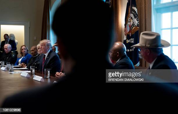 US President Donald Trump speaks during a meeting on border security in the Cabinet Room of the White House January 11 2019 in Washington DC