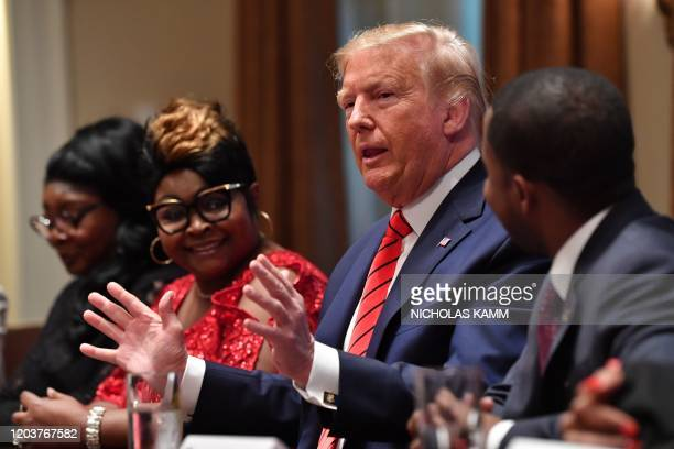 US President Donald Trump speaks during a meeting with AfricanAmerican leaders in the Cabinet Room of the White House in Washington DC on February 27...