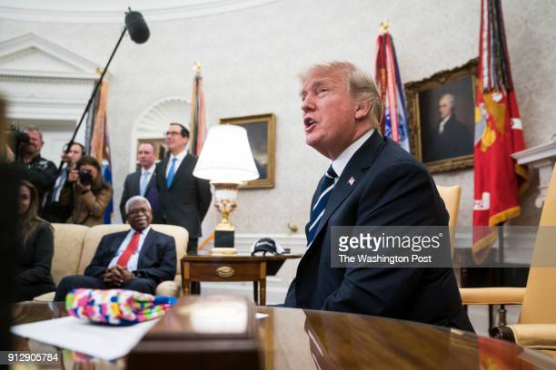 President Donald Trump speaks during a meeting with American workers on the impact of the new tax reform bill in the Oval Office at the White House...