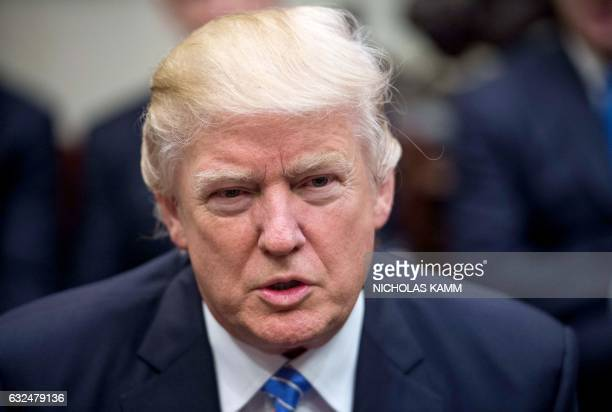 US President Donald Trump speaks during a meeting with business leaders in the Roosevelt Room at the White House in Washington DC on January 23 2017...