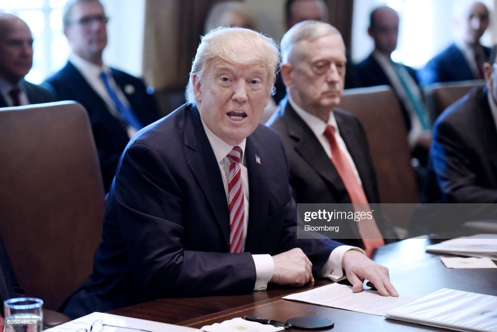 U.S. President Donald Trump Speaks During A Meeting With Cabinet Members At  The White House In