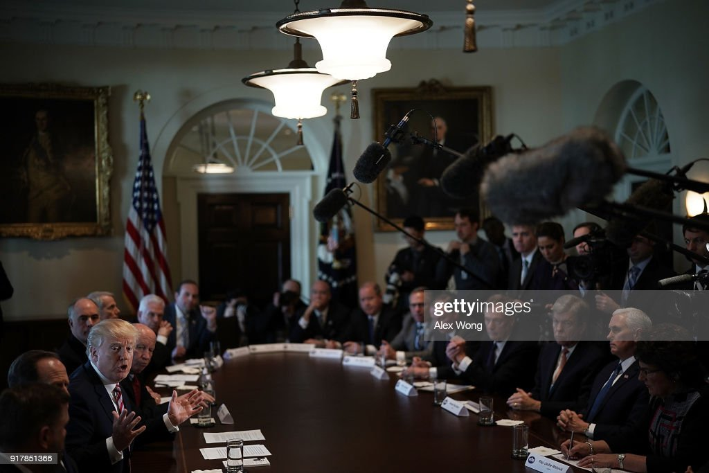 U.S. President Donald Trump (L) speaks during a meeting with congressional members in the Cabinet Room of the White House February 13, 2018 in Washington, DC. President Trump held a meeting with congressional members to discuss trade.