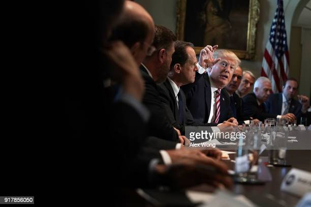 S President Donald Trump speaks during a meeting with congressional members in the Cabinet Room of the White House February 13 2018 in Washington DC...