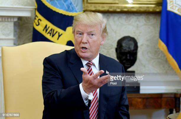US President Donald Trump speaks during a meeting with Don Bouvet who has been battling cancer in the Oval Office of the White House February 9 2018...
