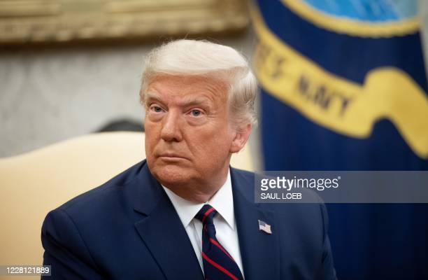 President Donald Trump speaks during a meeting with Iraqi Prime Minister Mustafa al-Kadhemi in the Oval Office of the White House in Washington, DC,...