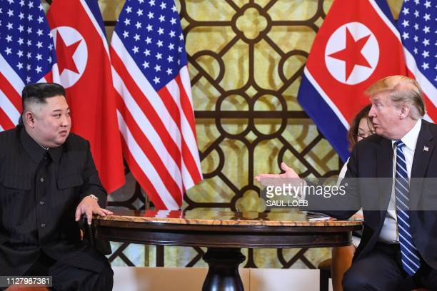 US President Donald Trump speaks during a meeting with North Korea's leader Kim Jong Un at the second USNorth Korea summit at the Sofitel Legend...