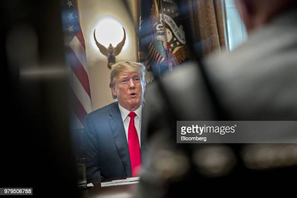US President Donald Trump listens during a meeting with Republican members of Congress in the Cabinet Room of the White House in Washington DC US on...