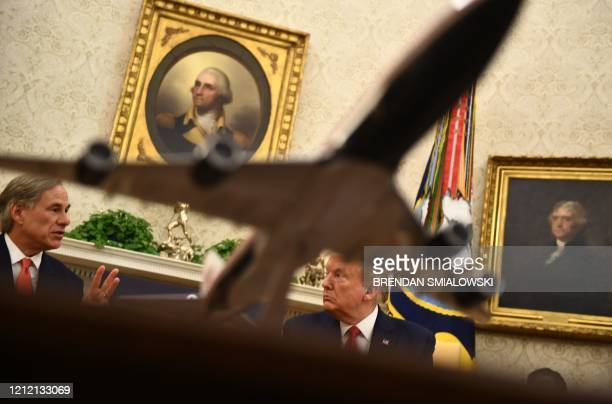 US President Donald Trump speaks during a meeting with Texas Governor Greg Abbott on May 7 in the Oval office of the White House in Washington DC