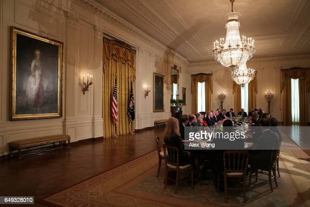 S President Donald Trump speaks during a meeting with the House Deputy Whip team at the East Room of the White House March 7 2017 in Washington DC...