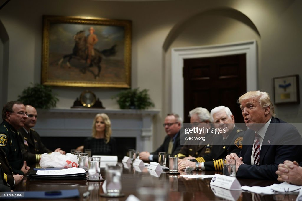 U.S. President Donald Trump (R) speaks during a meeting with the National Sheriffs Association in the Roosevelt Room of the White House February 13, 2018 in Washington, DC. President Trump met with representatives of the association to discuss law enforcement.