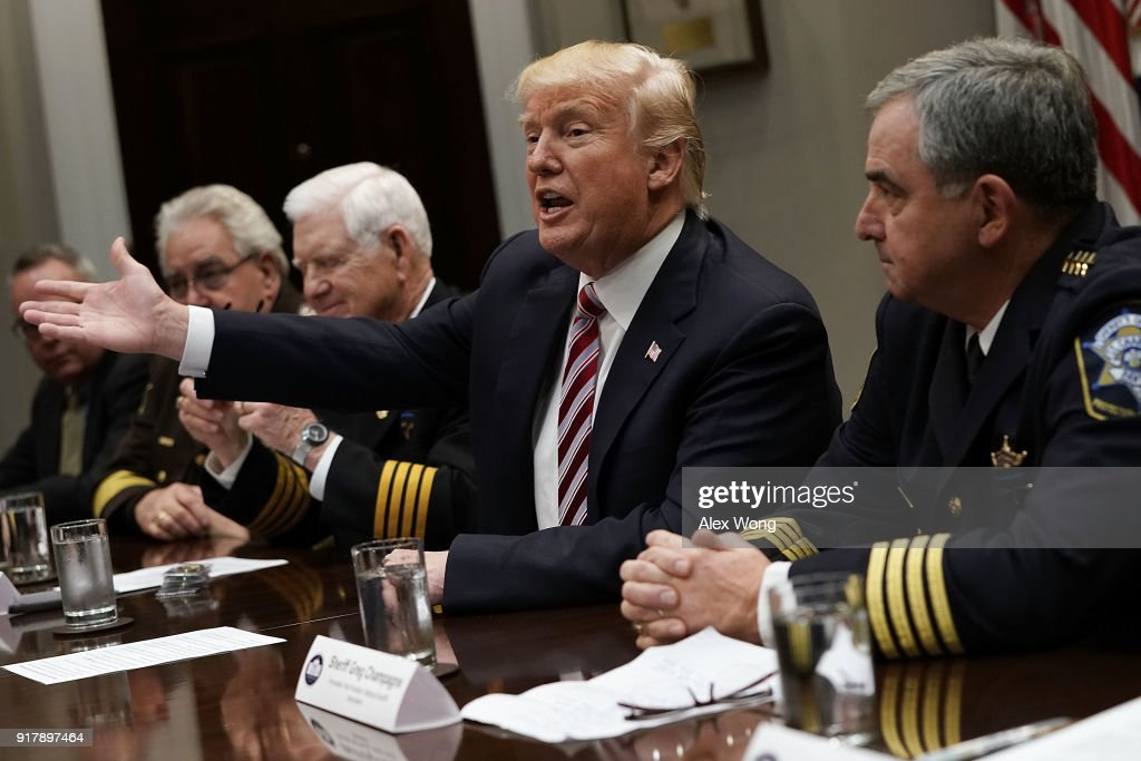 U.S. President Donald Trump (2nd R) speaks during a meeting with the National Sheriffs Association in the Roosevelt Room of the White House February 13, 2018 in Washington, DC. President Trump met with representatives of the association to discuss law enforcement.