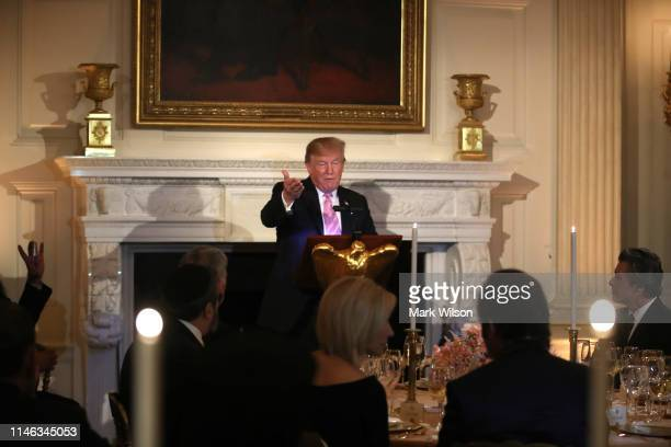 President Donald Trump speaks during a National Day of Prayer event in the State Dining Room at the White House on Thursday May 1 2019 in Washington...