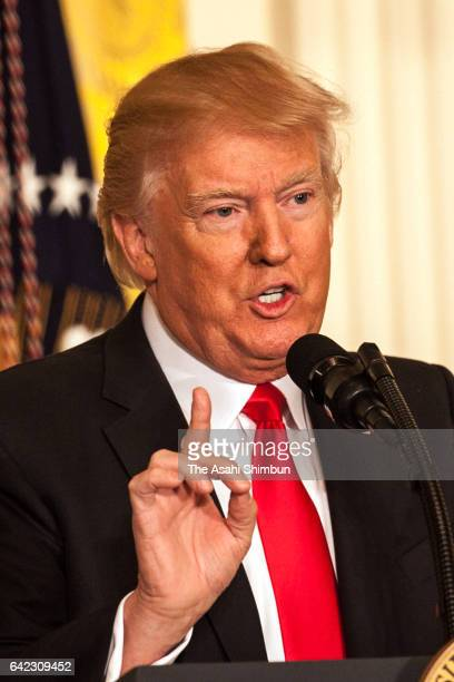 US President Donald Trump speaks during a news conference announcing Alexander Acosta as the new Labor Secretary nominee in the East Room at the...
