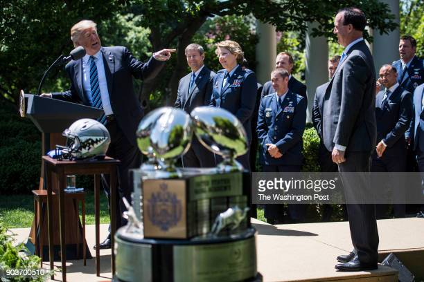 President Donald Trump speaks during a presentation ceremony of the CommanderinChief trophy to the Air Force Academy football team in the Rose Garden...
