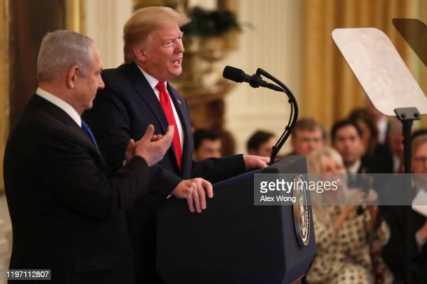 President Donald Trump speaks during a press conference with Israeli Prime Minister Benjamin Netanyahu in the East Room of the White House on January...