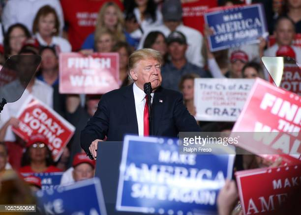 President Donald Trump speaks during a rally at the International Air Response facility on October 19 2018 in Mesa Arizona President Trump is holding...