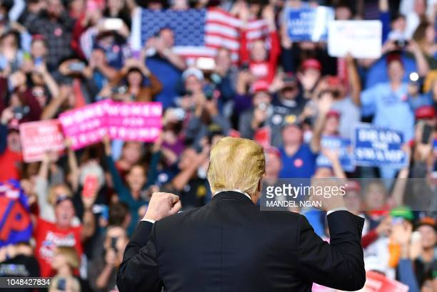 US President Donald Trump speaks during a rally at the MidAmerica Center in Council Bluffs Iowa on October 9 2018