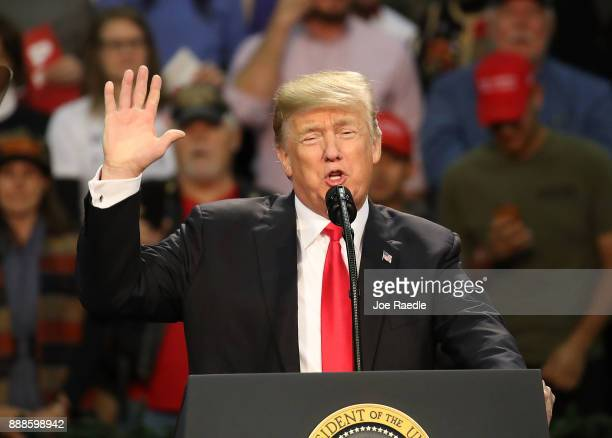 S President Donald Trump speaks during a rally at the Pensacola Bay Center on December 8 2017 in Pensacola Florida Mr Trump was expected to further...