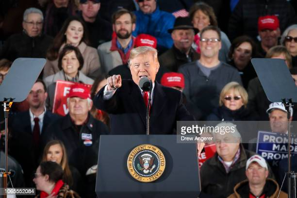 President Donald Trump speaks during a rally at the Tupelo Regional Airport November 26 2018 in Tupelo Mississippi President Trump is holding two...