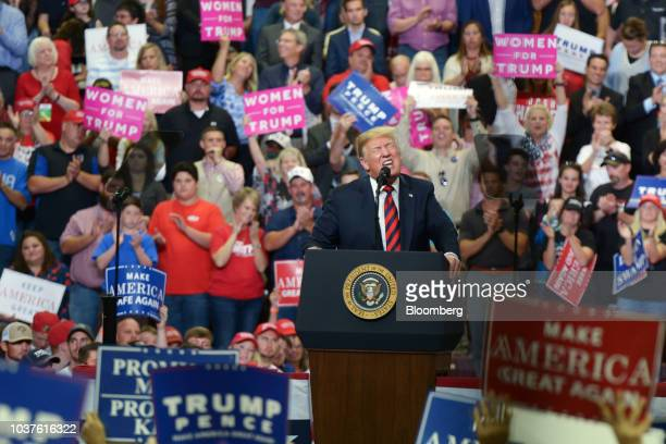 Josh Hawley Republican senate candidate for Missouri right speaks as US President Donald Trump gives thumbs up during a rally in Springfield Missouri...