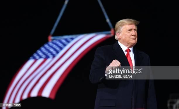 President Donald Trump speaks during a rally in support of Republican incumbent senators Kelly Loeffler and David Perdue ahead of Senate runoff at...