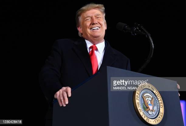 President Donald Trump speaks during a rally in support of Republican incumbent senators Kelly Loeffler and David Perdue ahead of Senate runoff in...