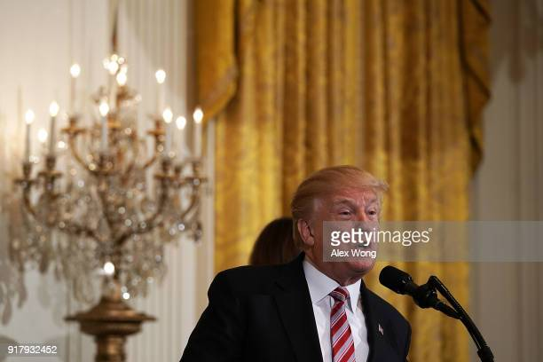 S President Donald Trump speaks during a reception in the East Room of the White House February 13 2018 in Washington DC President Trump and first...