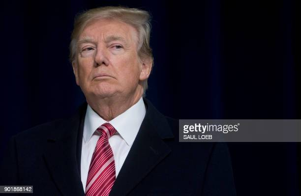 President Donald Trump speaks during a retreat with Republican lawmakers at Camp David in Thurmont, Maryland, January 6, 2018. / AFP PHOTO / SAUL LOEB