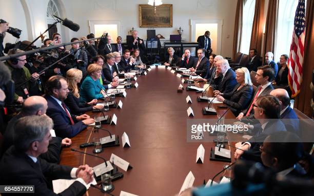 President Donald Trump speaks during a roundtable discussion on vocational training with German Chancellor Angela Merkel and United States and German...