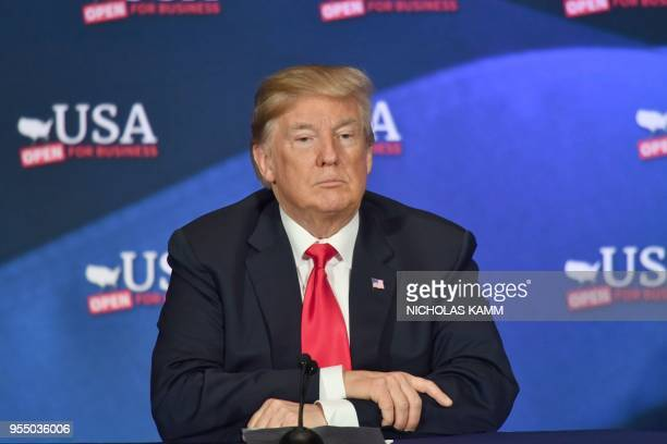 US President Donald Trump speaks during a roundtable discussion on the new tax law at the Cleveland Public Auditorium and Conference Center on May 5...