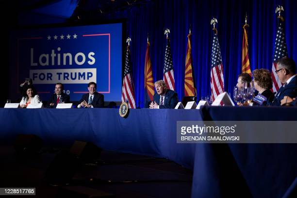 President Donald Trump speaks during a roundtable rally with Latino supporters at the Arizona Grand Resort and Spa in Phoenix, Arizona on September...
