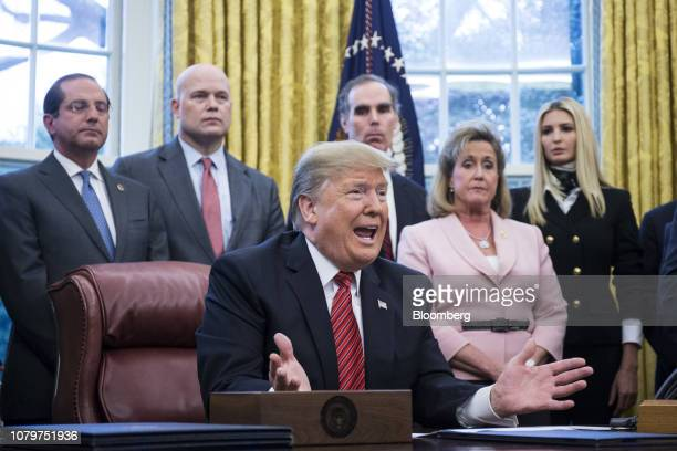 US President Donald Trump speaks during a signing ceremony for antihuman trafficking legislation in the Oval Office at the White House in Washington...