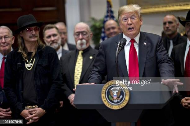 US President Donald Trump speaks during a signing ceremony for HR 1551 the HatchGoodlatte Music Modernization Act in the Roosevelt Room of the White...